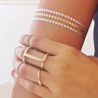 Metallic tats